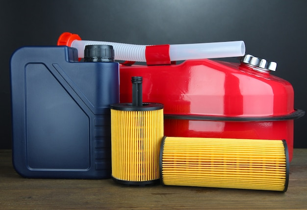 Diesel and oil canisters on grey