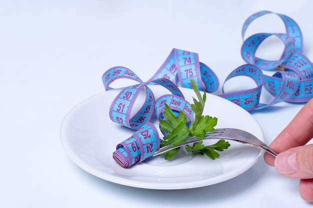 ダイエットと減量の概念。