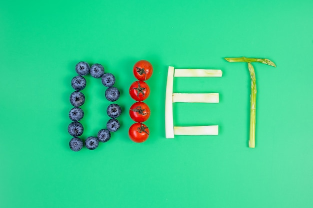 Diet arrangement of fruit and vegetable on green background