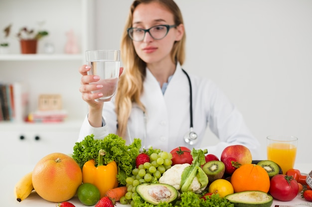 Diet concept with female scientist and healthy food