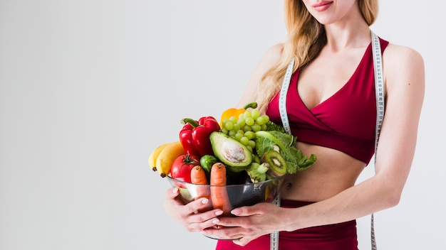 Diet concept with sport woman and healthy food