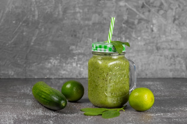 Diet and detox concept. green smoothie with spinach, banana, kiwi and apple juice. clean eating and healthy food.