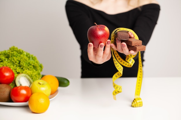 Diet and healthy concept, nutritionist in her office.
