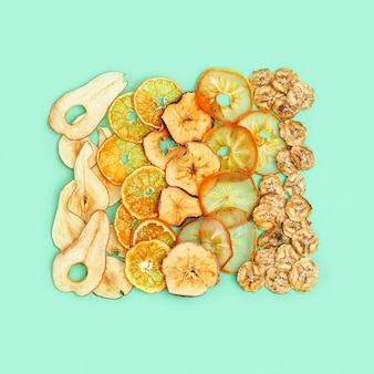 Diet healthy snack, set of dried fruits, dehydrated fruit chips of apple, banana, persimmon, tangerine, pear.