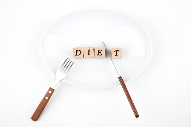 Diet letters in a plate with fork and knife