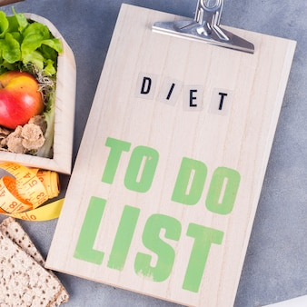 Diet to do list with healthy food on table