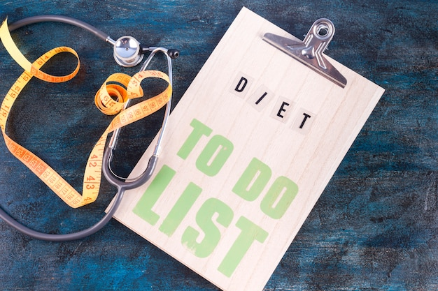 Diet to do list with measuring tape on table