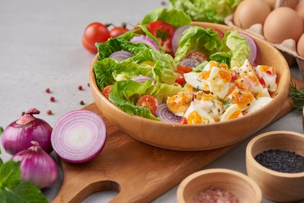 Diet menu. healthy salad of fresh vegetables tomatoes, egg, onion. healthy meal concept.