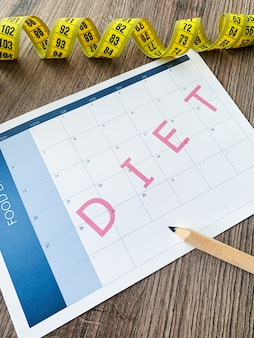 Diet plan concept. measuring tape and diet plan
