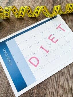 Diet plan concept, measuring tape and diet plan