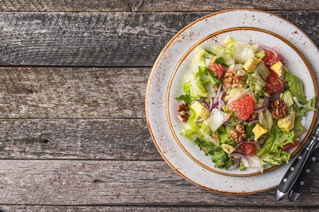 Diet salad  garpefruit, cheese, lettuce and walnut on a plate. diet and healthy salad   . top view
