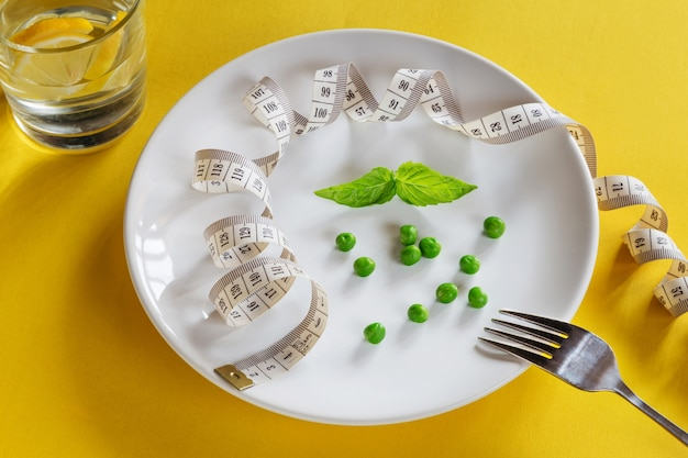Diet white plate with centimeter