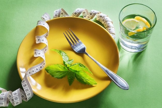 Diet yellow plate with centimeter