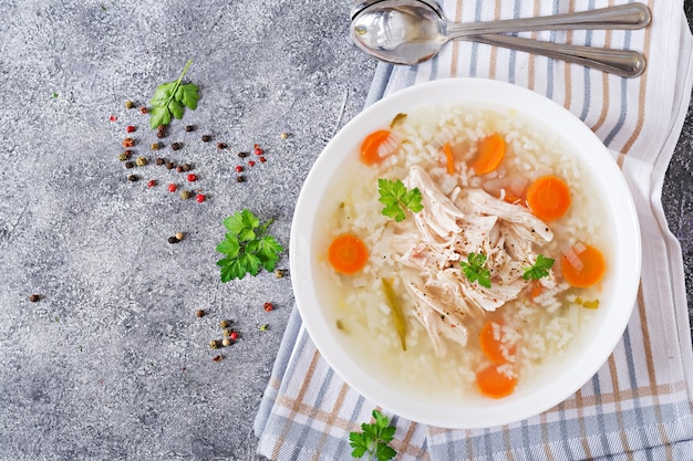 Dietary chicken soup with rice and carrots.