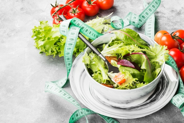 The dietary mixed greens salad and cherry tomatoes in a bowl