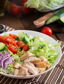 Dietary salad with chicken, avocado, cucumber, tomato and chinese cabbage
