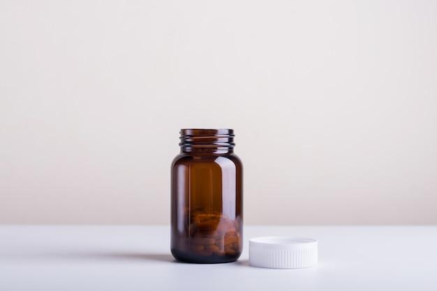 Dietary supplement bottles of a lid open set