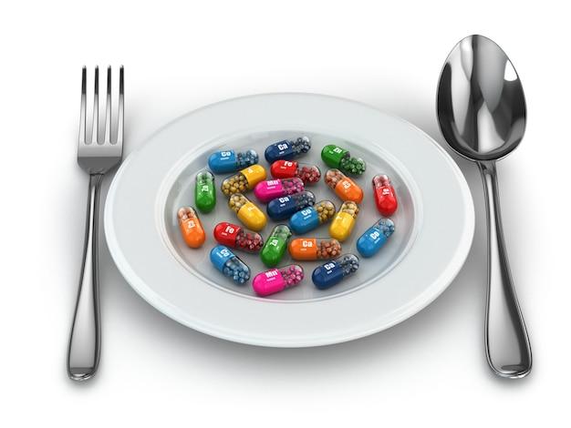ダイエットサプリメント。さまざまな錠剤。プレート上のビタミンカプセル。 3d