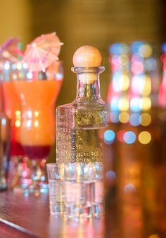 Different alcohol drinks and cocktails on bar.