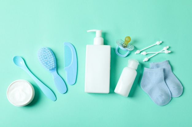 Different baby hygiene accessories on mint
