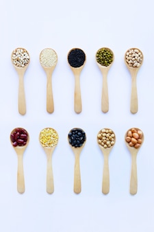 Different beans, legumes on wooden spoon