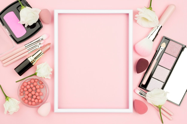 Different beauty products arrangement with empty frame
