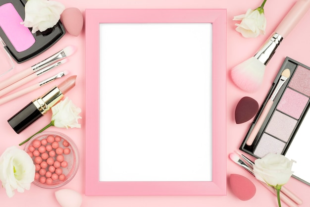 Different beauty products assortment with empty frame