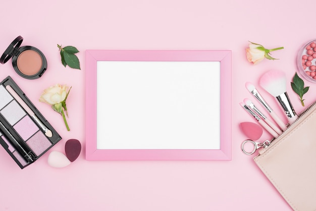 Different beauty products composition with empty frame