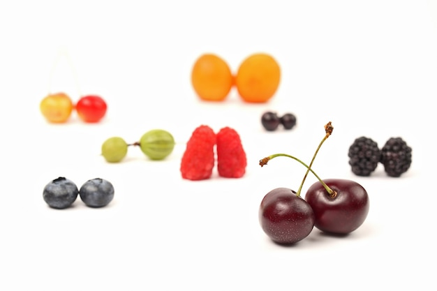 Different berries are paired on a white background