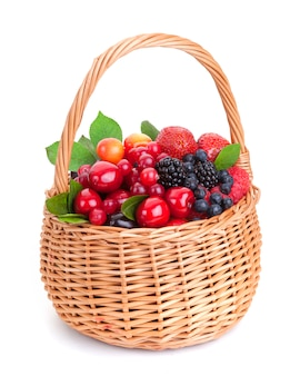 Different berries in basket on white background
