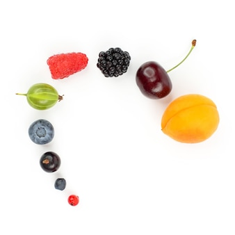 Different berries laid out for each other on white background. vitamin healthy food
