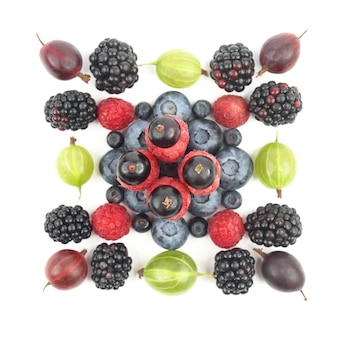 Different berries on a white background. healthy fresh vegetables and food