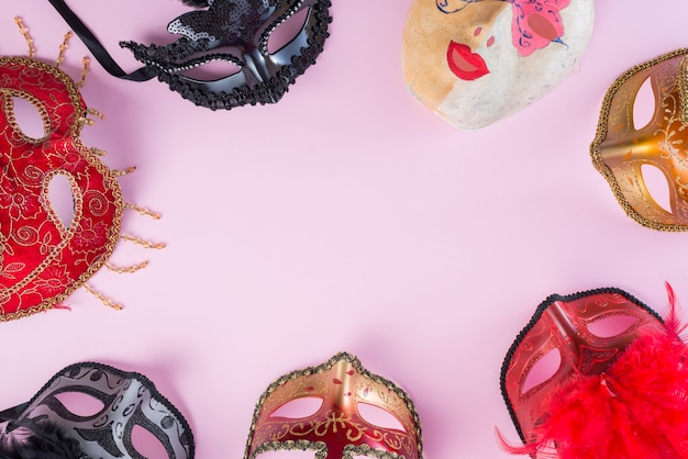 Different carnival masks on table