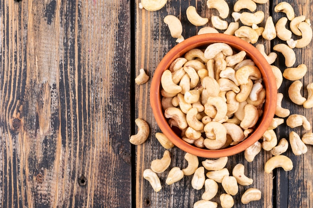 Different cashews on wooden table, top view.