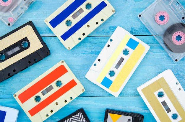 Different cassette tape collection on wooden surface