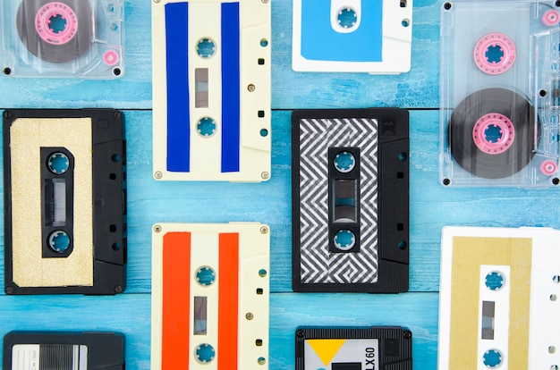 Different cassette tapes arrangement on wooden surface