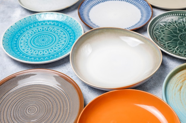 Different ceramic empty plates and bowls. Free Photo