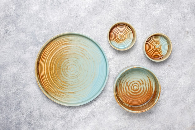Different ceramic empty plates and bowls.