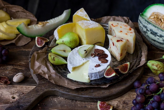The different cheese and fresh fruits