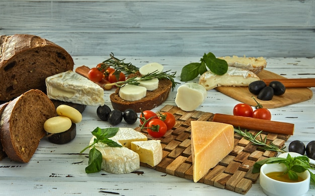Different cheeses on table