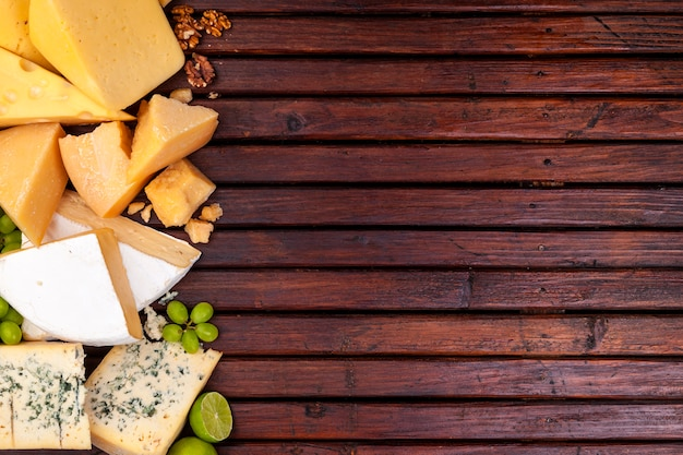 Different cheeses on wooden surface table