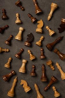 Different chess pieces pattern on dark background
