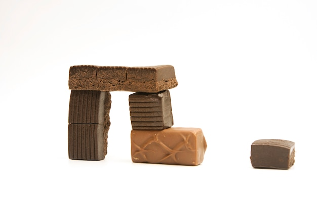 Different chocolate pieces on white background
