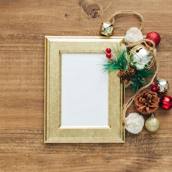 Different christmas ornaments with golden frame