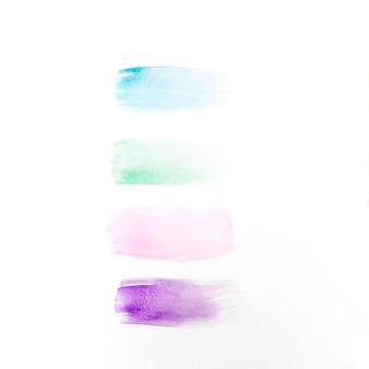 テーブル上の異なる色のブラシストローク