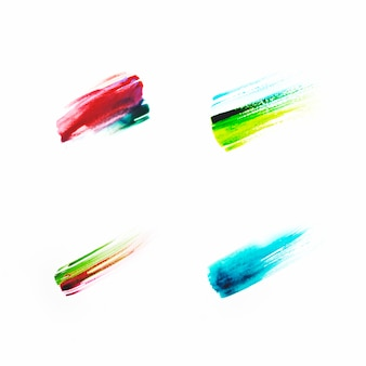 Different colored brushstrokes on paper