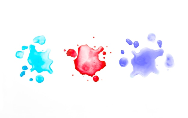 Different colored stains of watercolor paint