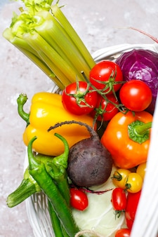 Different colorful fresh vegetables on concrete surface