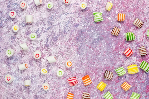 Different colorful sugar candies, top view