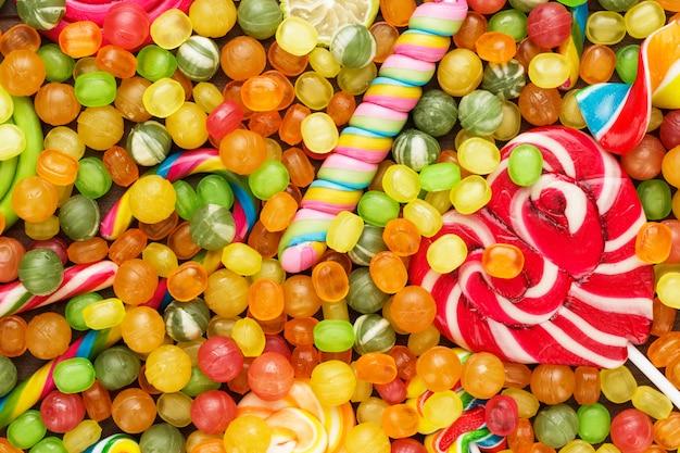 異なるカラフルなお菓子とロリポップのテクスチャ
